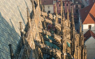 What did flying buttresses allow the architecture of the gothic church to do?